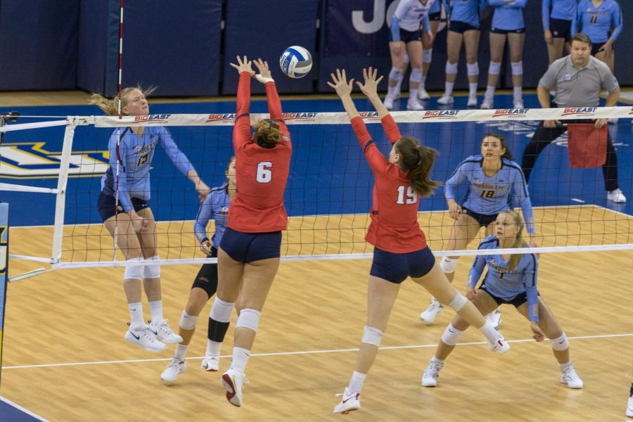 St. John's Efrosini Alexakou (6) and Ariadni Kathariou (19) go up for a block against Marquette in the Red Storm's 3-1 victory at the Al McGuire Center. This is the first time since 2007 St. John's has won the BIG EAST Tournament title.
