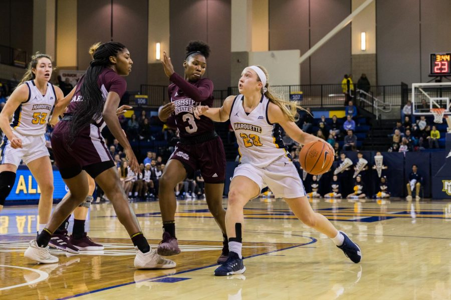 Jordan King (23) tied Isabelle Spingola with 12 points to lead the Golden Eagles in Marquette's 53-51 win over Belmont Saturday.