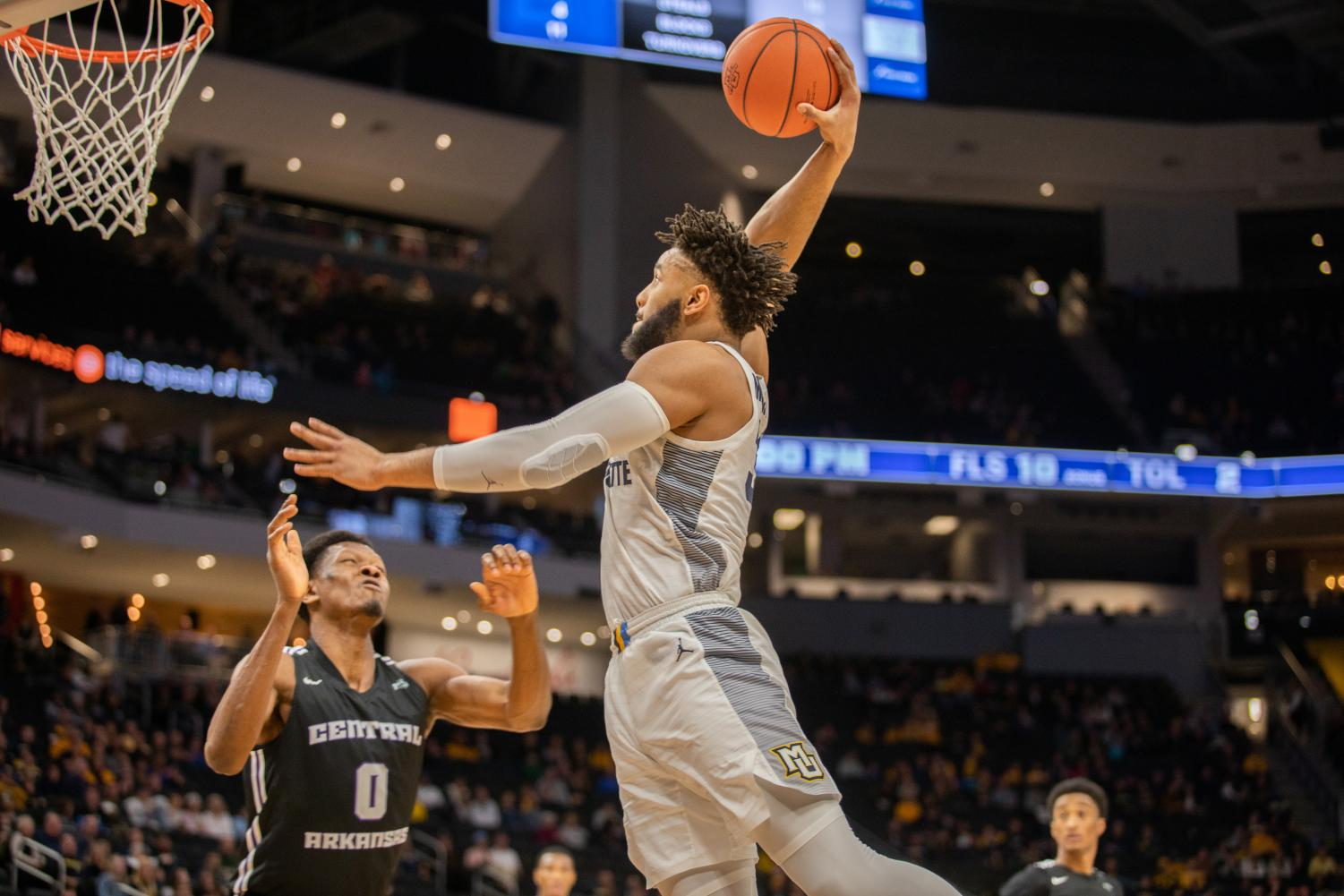 Redshirt senior Ed Morrow attempts a dunk in the second half of Marquette's 52-point win over Central Arkansas Dec. 28 at Fiserv Forum.