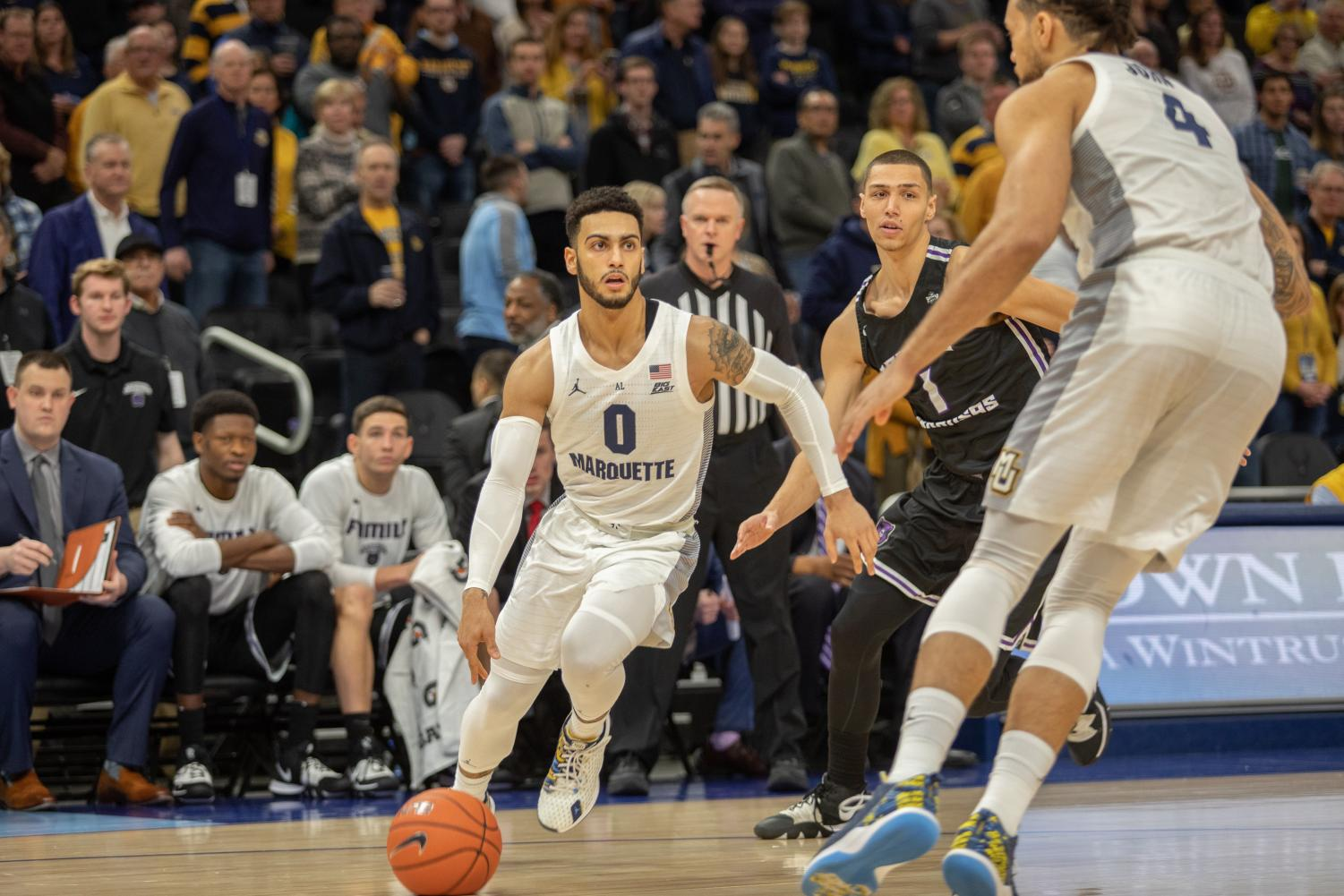 Markus Howard (0) drives to the paint in Marquette's 106-54 win over Central Arkansas Saturday afternoon.