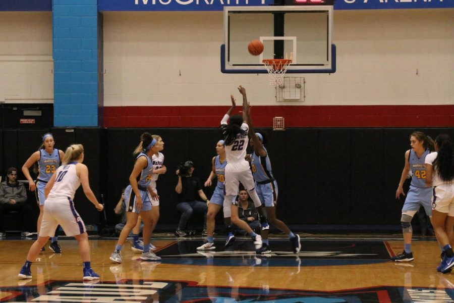 DePaul's Chante Stonewall (22) attempts a shot in the Blue Demons' 89-71 victory over the Golden Eagles Sunday night. Stonewall totaled 20 points.