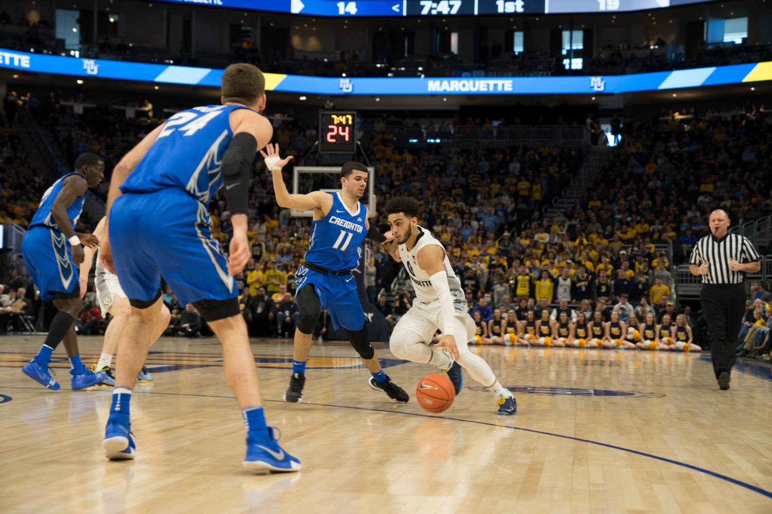 Markus Howard (0) guarded closely by Creighton's Marcus Zegarowski (11) in the Bluejay's 66-60 upset of the then-No. 10 Golden Eagles March 3 at Fiserv Forum.