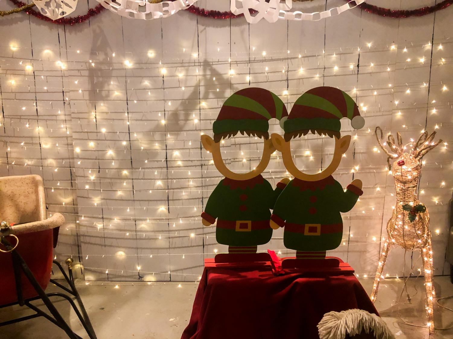 The venue provides a special opportunity where attendees can take pictures with elf body cutouts. The bar is furnished with holiday decorations inspired by the popular film.