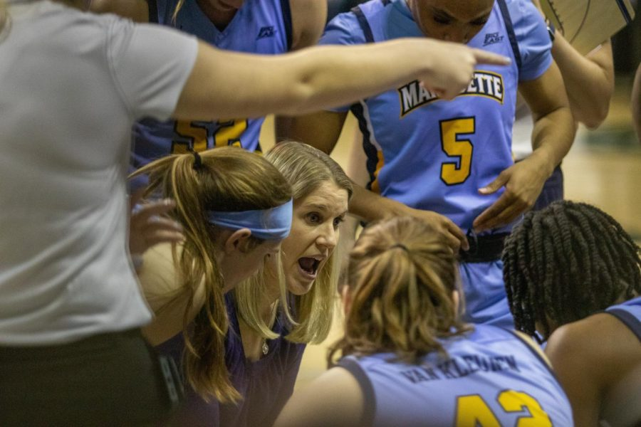 Megan Duffy (center) leads the huddle in Marquettes victory over University of Wisconsin-Green Bay.