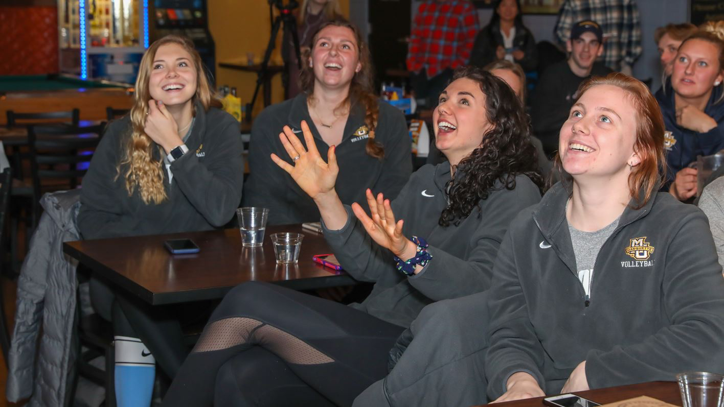 Hope Werch, Allie Barber, Gwyn Jones and Martha Konovodoff (from left to right) react to 2019 Selection Show. (Photo courtesy of Marquette Athletics.)