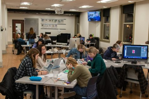 Marquette Wire reporters, editors and designers work diligently during Dec. 2, 2019, production for the Marquette Tribune.