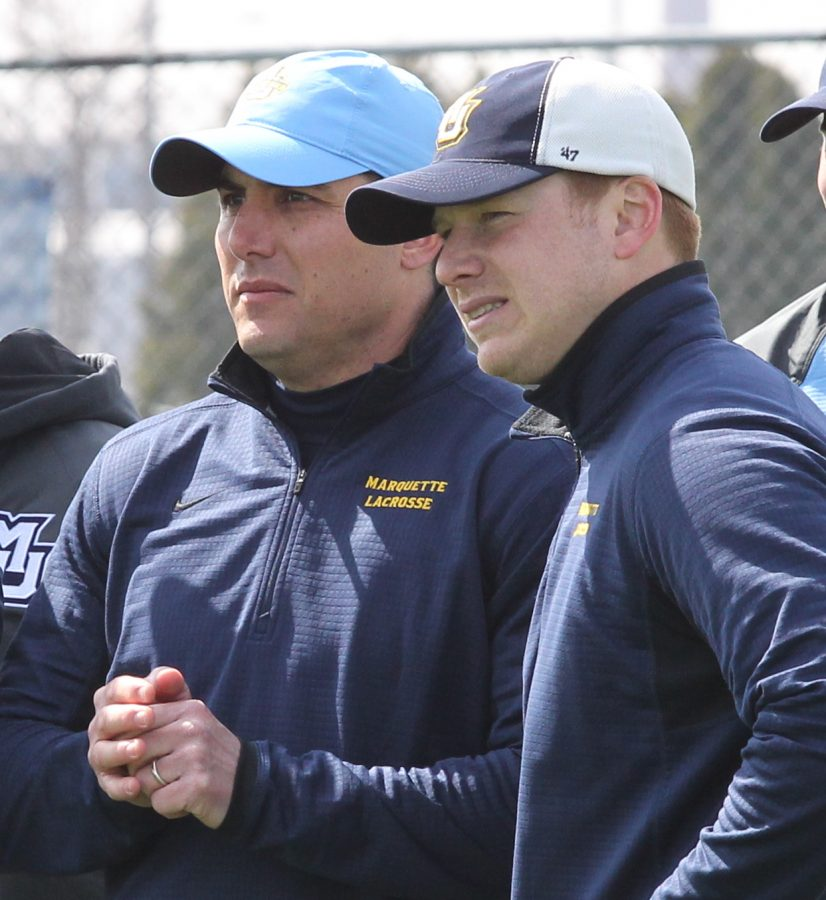 Andrew Stimmel coaches on the sidelines with former head coach Joe Amplo. (Photo courtesy of Marquette Athletics.)