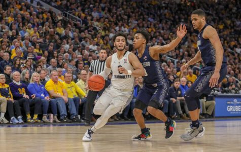 Markus Howard (0) dribbles past Georgetown's defense in the Golden Eagles' 86-84 loss to the Hoyas March 9, 2019 for Senior Day. This was MU's fourth straight loss to end last year's regular-season. (Photo courtesy of Marquette Athletics.)
