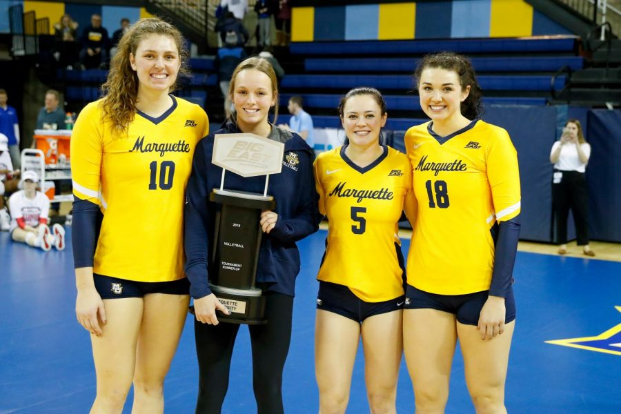 Seniors Allie Barber (10), Madeline Mosher (second from left), Lauren Speckman (5) and graduate transfer Gwyn Jones (18) hold the BIG EAST runner-up trophy. Marquette fell to St. John's in the title match. (Photo courtesy of Marquette Athletics.)