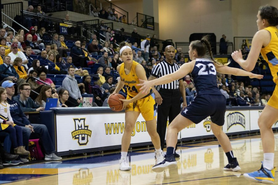Selena Lott (24) looks for a teammate to pass to in Marquette's win over Xavier Feb. 24, 2019 at the Al McGuire Center. (Marquette Wire stock photo.)