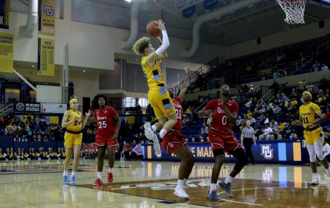 Natisha Hiedeman (5) goes up for a shot in Marquette's 83-73 win over St. John's at the Al McGuire Center last season.
