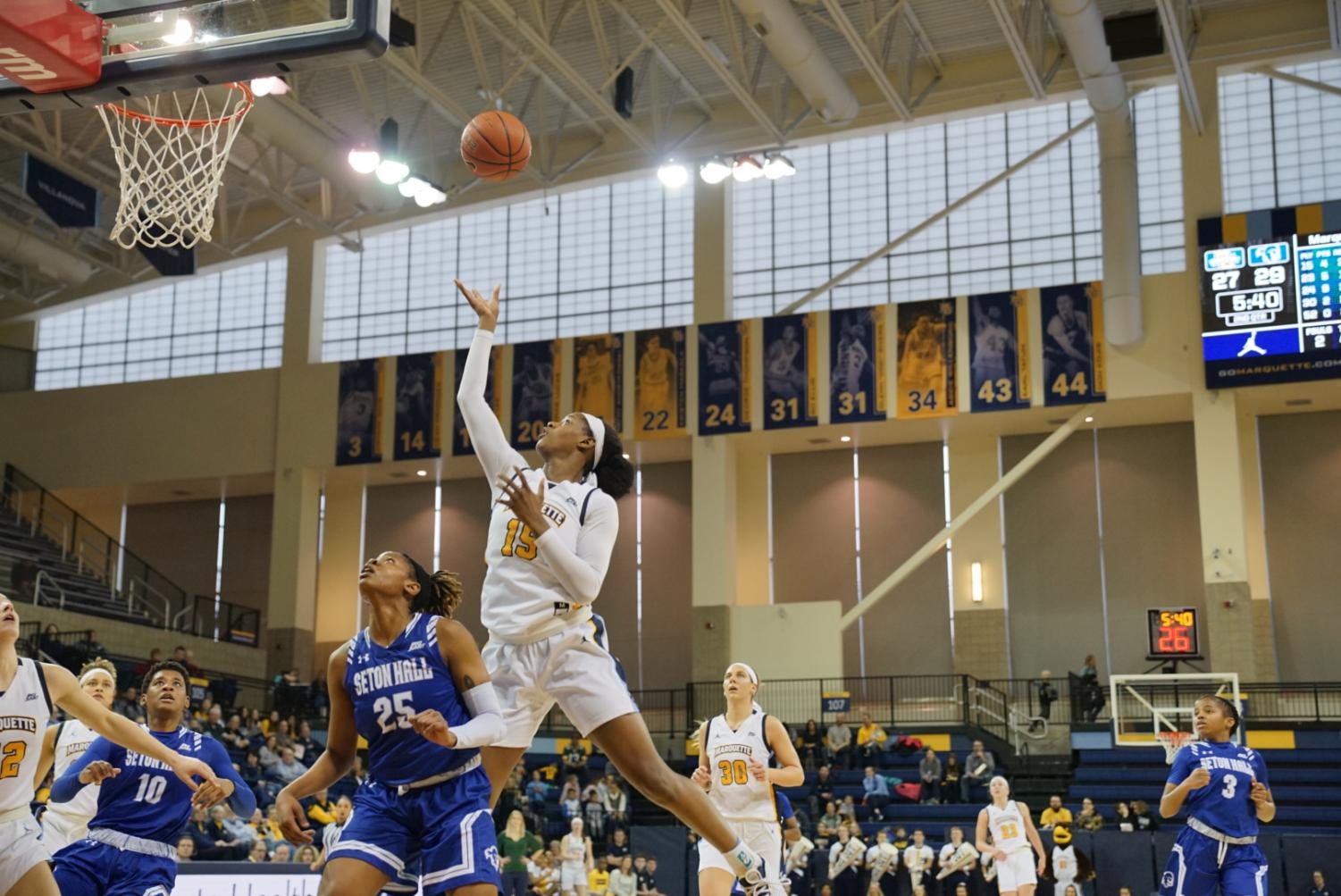 Camryn Taylor (15) contributed a career-high 23 points in Marquette's win over Seton Hall Sunday.