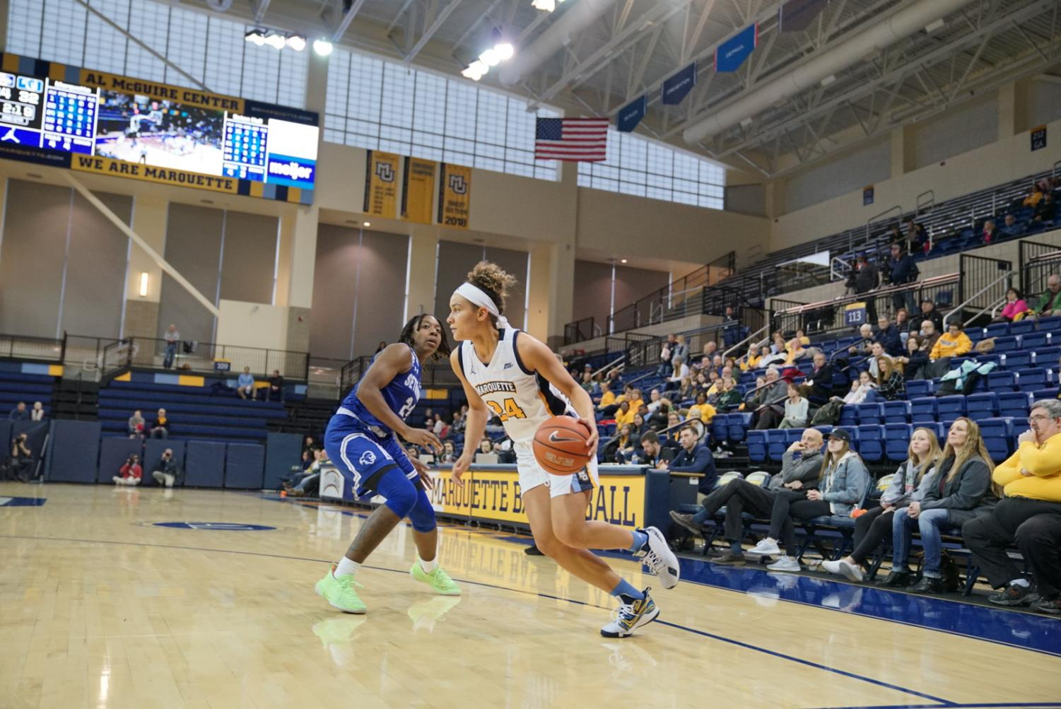 Selena Lott (24) dribbles the basketball in the Golden Eagles' 81-60 victory over the Pirates Sunday afternoon. She had 19 points.