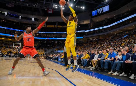 Sacar Anim (2) shoots a 3-pointer in Marquette's 82-68 victory over St. John's at Fiserv Forum.