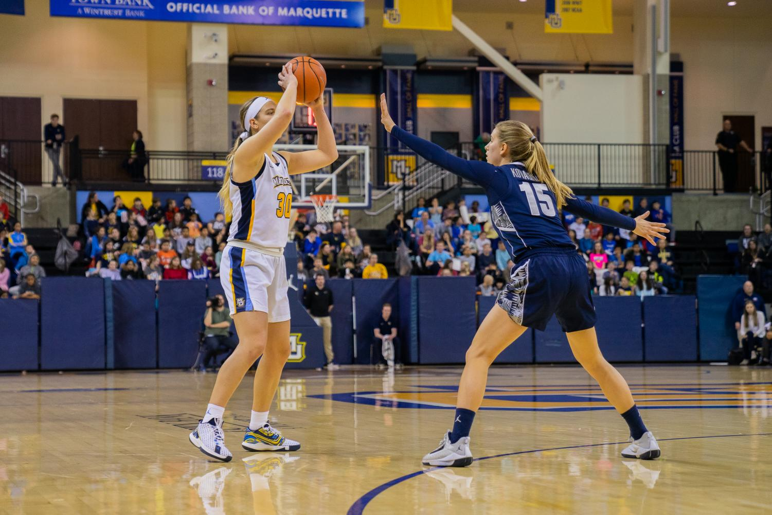 Isabelle Spingola (30) looks for a teammate to pass to in Marquette's win over Georgetown Friday afternoon.