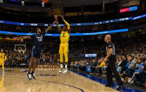 Sacar Anim (2) shoots a 3-pointer in Marquette's win over Xavier at Fiserv Forum Jan. 15.