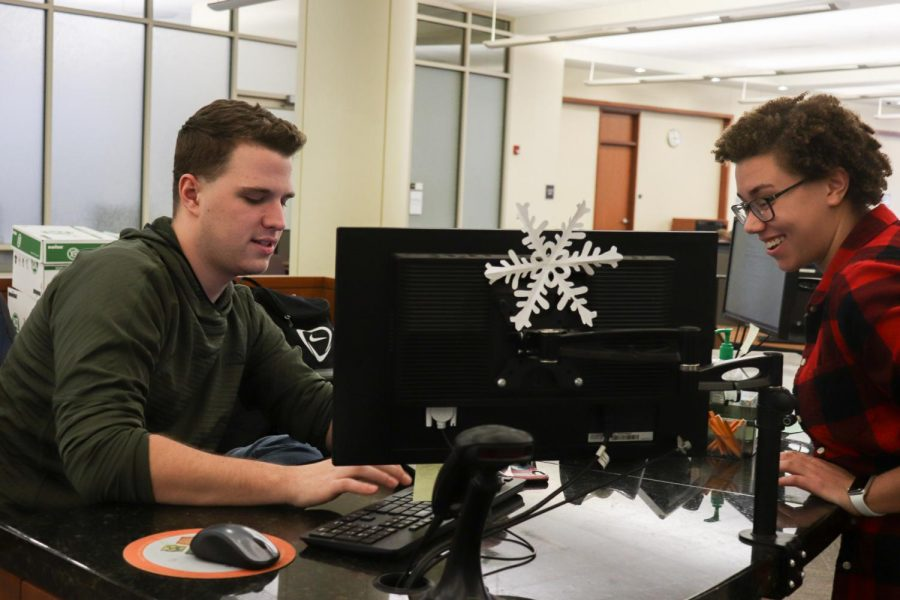 Daniel Dewald, a junior in the College of Health Sciences, and Katie Ruszkowski,  a sophomore in the College of Arts & Sciences, interact at Raynor Library.