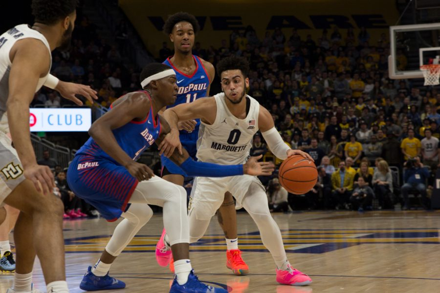Markus+Howard+%280%29+drives+toward+the+basket+in+Marquette%27s+79-69+win+over+DePaul+Jan.+23%2C+2019+at+Fiserv+Forum.+%28Marquette+Wire+stock+photo.%29