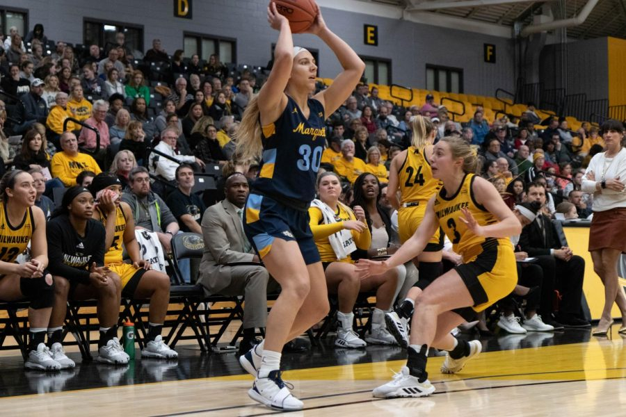 Isabelle Spingola (30) looks for a pass in Marquette's 78-56 win over University of Wisconsin-Milwaukee Dec. 8.