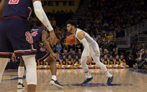 Markus Howard (0) dribbles the ball in Marquette's 70-69 loss to St. John's at Fiserv Forum Feb. 5, 2019. (Marquette Wire stock photo.)