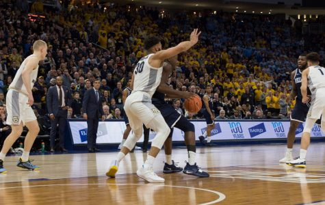 Ed Morrow (30) made the defensive stop in Marquette's 66-65 upset against Villanova at Fiserv Forum Feb. 9, 2019. (Marquette Wire stock photo).
