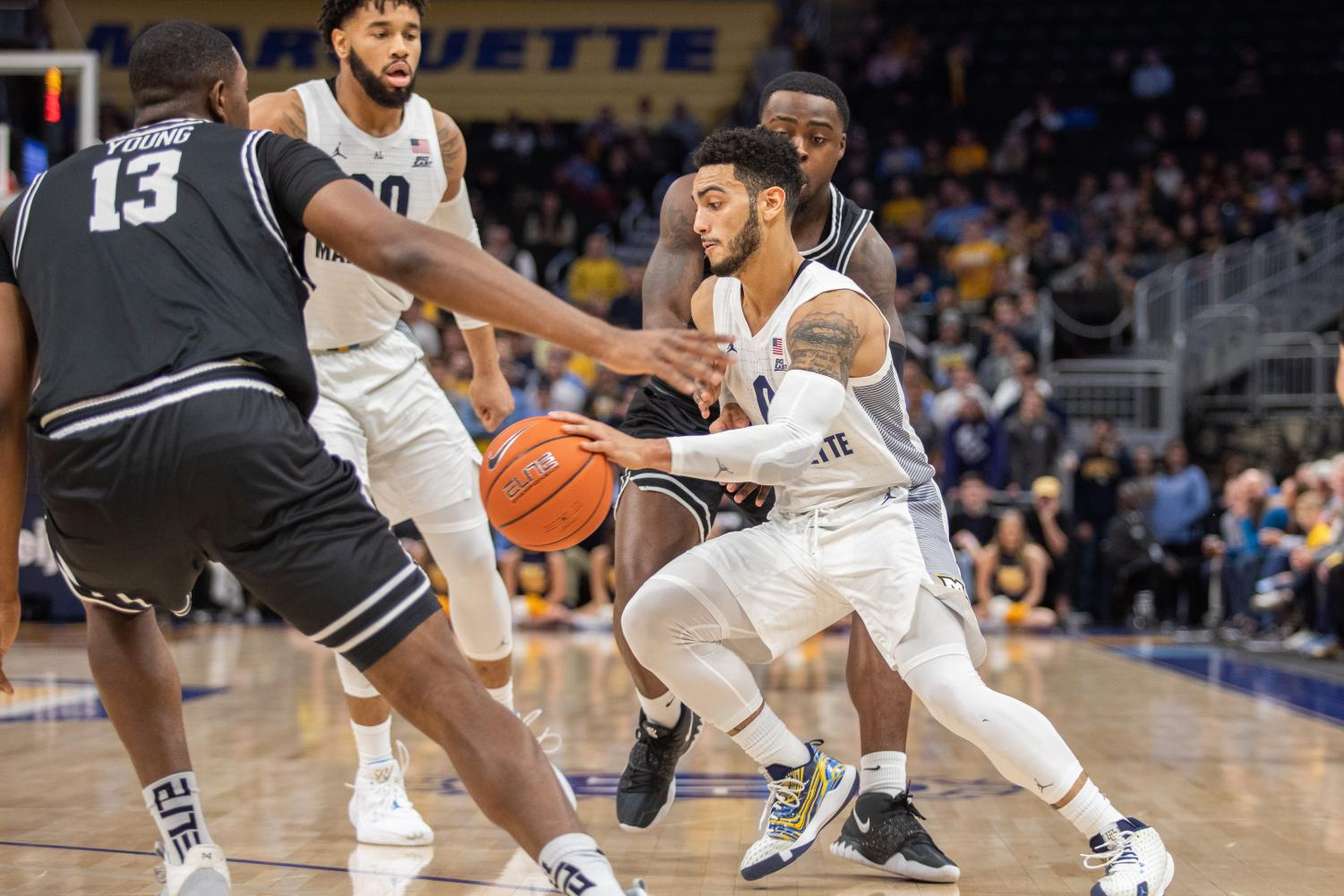 Markus Howard (0) dribbles the ball in Marquette's 81-80 overtime loss to Providence. The senior guard scored 39 points.