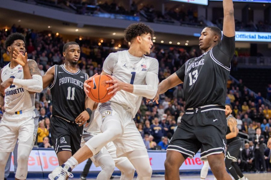 Brendan Bailey (1) is guarded by Providences (13) Khalif Young. Bailey put up 19 points in Marquettes 81-80 loss at Fiserv Forum Tuesday night.
