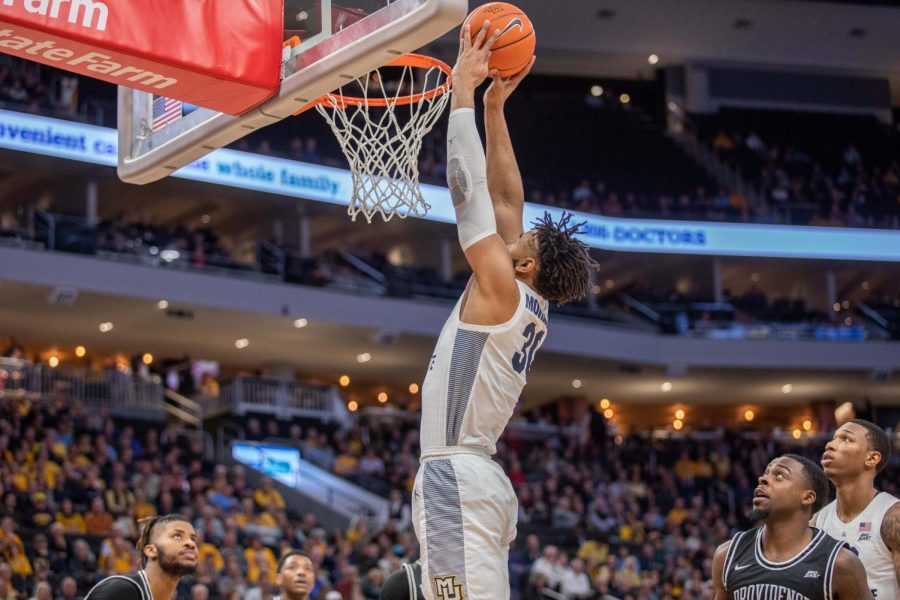 Ed Morrow (30) dunks a basketball in Marquette's 81-80 overtime loss to Providence Jan. 7.