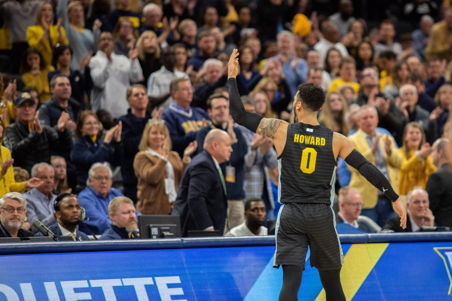 Markus Howard (0) pumps up the crowd at Fiserv Forum Jan. 4. The Golden Eagles went on to upset the then-No. 10 Villanova Wildcats 71-60.