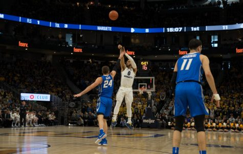 Markus Howard (0) is closely guarded by Mitch Ballock (24) in Marquette's 66-60 loss to Creighton at Fiserv Forum March 3.