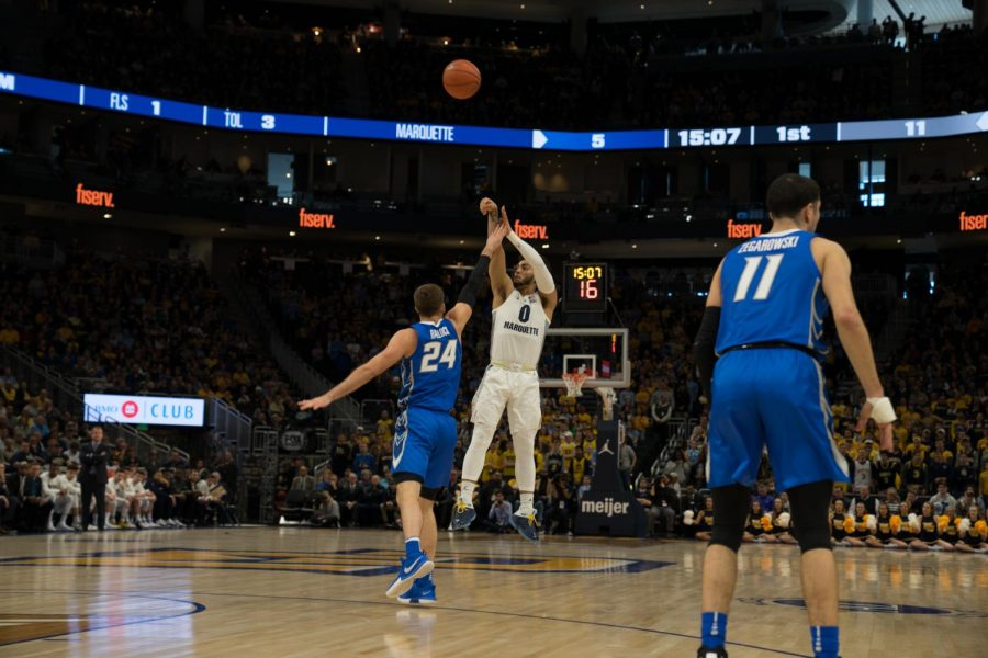 Markus+Howard+%280%29+is+closely+guarded+by+Mitch+Ballock+%2824%29+in+Marquette%27s+66-60+loss+to+Creighton+at+Fiserv+Forum+March+3.+