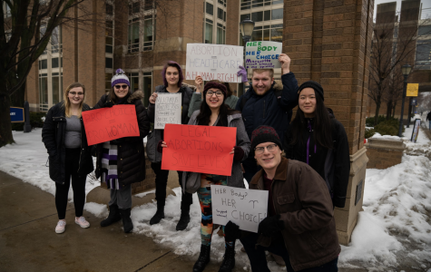 Students held up signs supporting abortion.