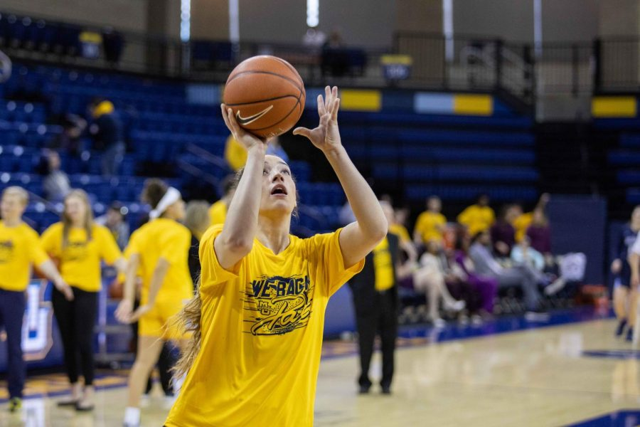 Chloe Marotta wears the We Back Pat shirt in Marquettes Alzheimers Awareness game Sunday afternoon.