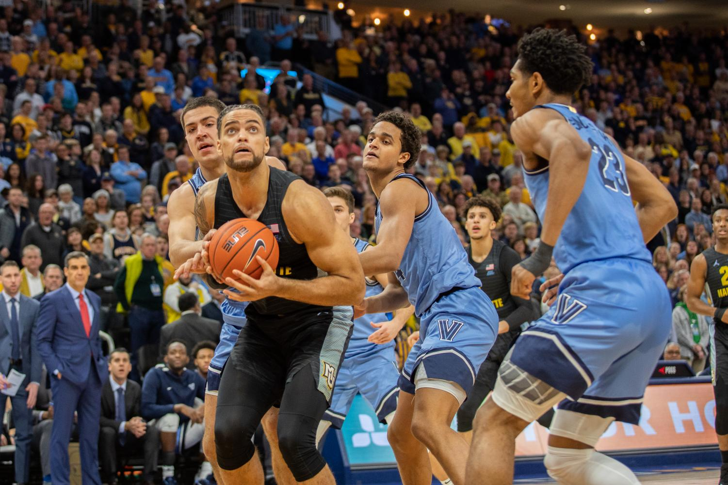 Theo John (4) had a season-best 10 rebounds in Marquette's 71-60 win over No. 10 Villanova.