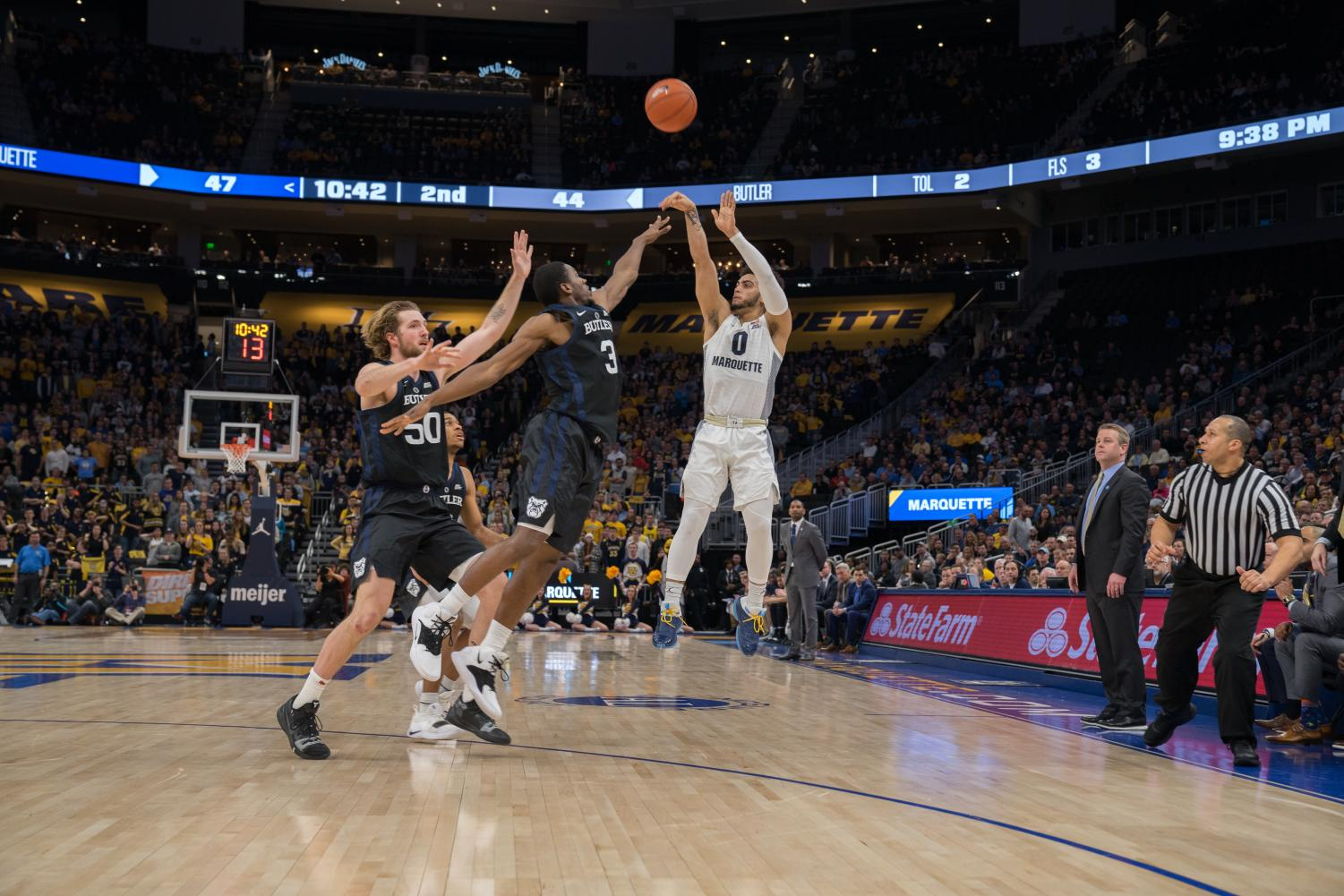 Markus Howard (0) attempts a 3-pointer in Marquette's 79-69 win over Butler at Fiserv Forum Feb. 20, 2019.