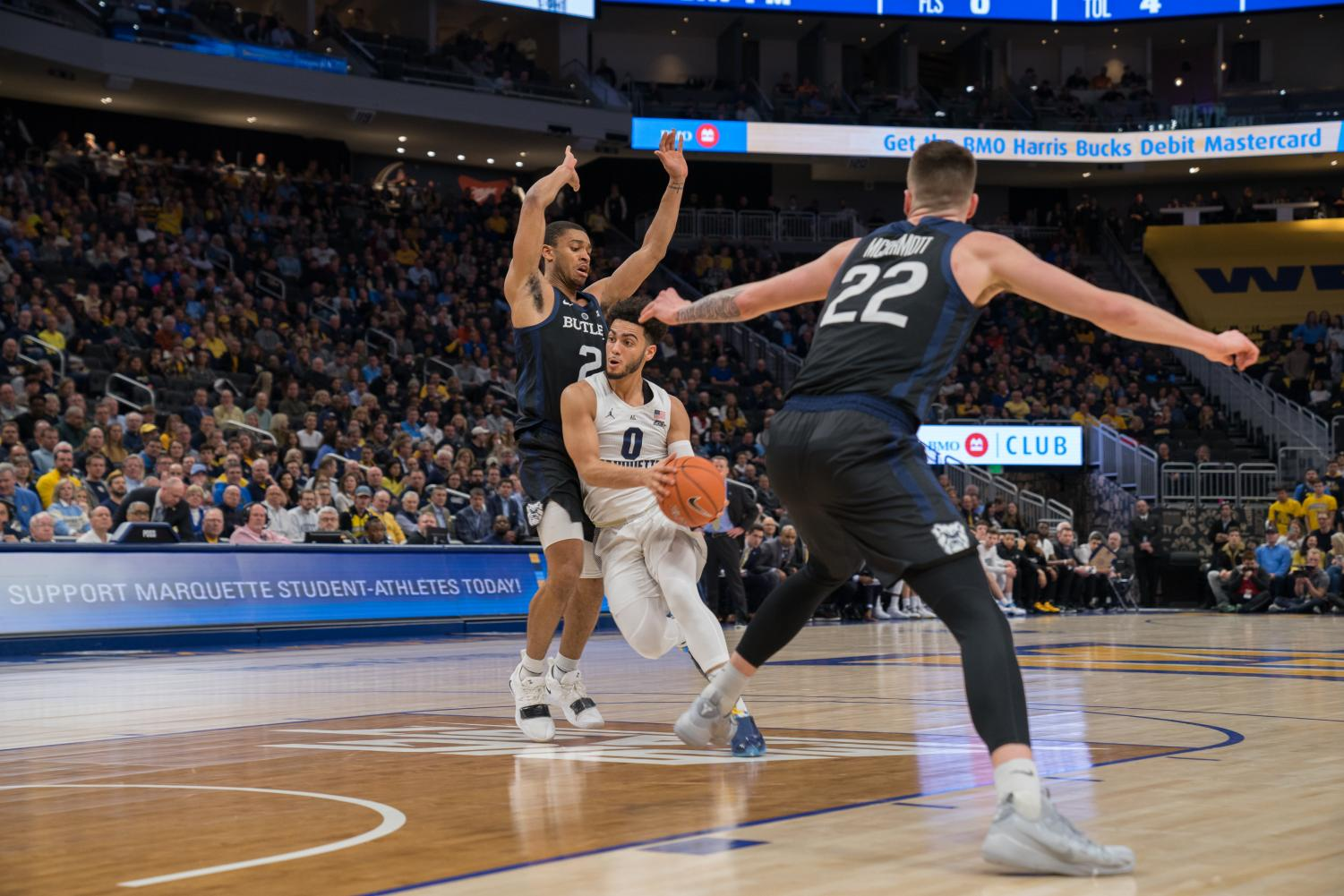 Markus Howard (0) dribbles in Marquette's 79-69 win over Butler at Fiserv Forum Feb. 20, 2019.