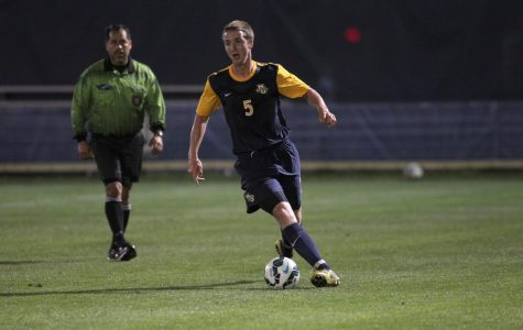 Danny Jarosz looks for a pass in Marquette's blue and gold scrimmage Aug. 14, 2014. (Photo courtesy of Marquette Athletics.)