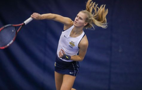 Fleur Eggink serves during practice. (Photo courtesy of Marquette Athletics.)