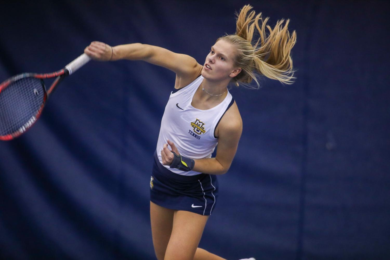 Fleur Eggink serves during practice. (Photo courtesy of Marquette Athletics.)