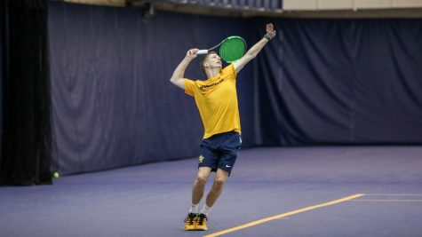 Brett Meyers serves in practice Feb. 9. (Photo courtesy of Marquette Athletics.)