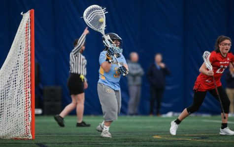 Juliana Horning (31) gets ready to clear the ball in Marquette's 17-6 win over Cincinnati on Feb. 14. (Photo courtesy of Marquette Athletics.)