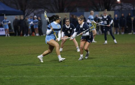 Caroline Steller (4) goes on a defender heading to the net in Marquette's 17-10 loss to Georgetown on May 2, 2019.  (Marquette Wire Stock Photo.)