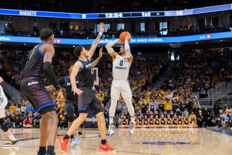 Men's basketball falls flat against Michigan