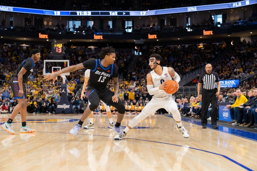 Markus Howard (0) takes a step back in Marquettes win over DePaul.