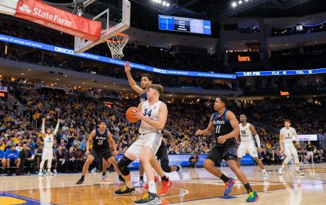 Jayce Johnson (34) had 11 points and six rebounds in Marquette's win over DePaul Saturday.