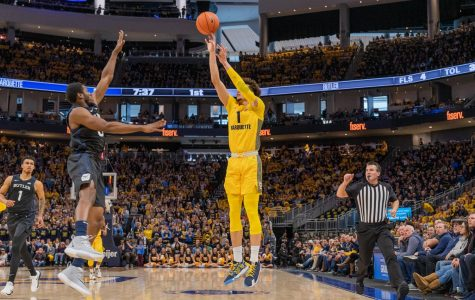 Brendan Bailey (1) attempts a three-pointer in Marquette's 76-57 over Butler on National Marquette Day Sunday.