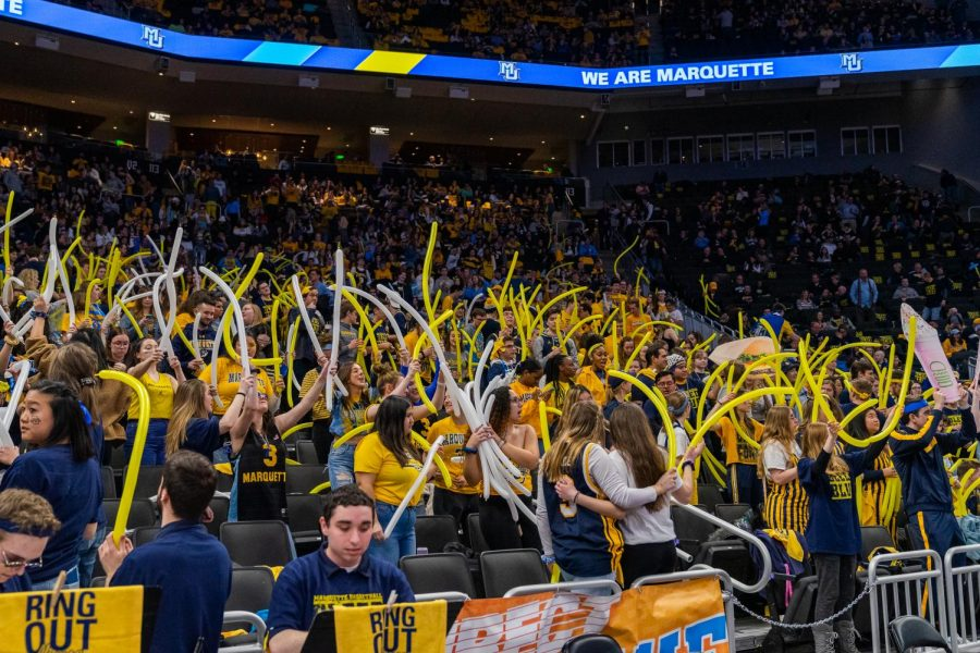 Students celebrate National Marquette Day  at the men's basketball game against Butler University Feb. 9.