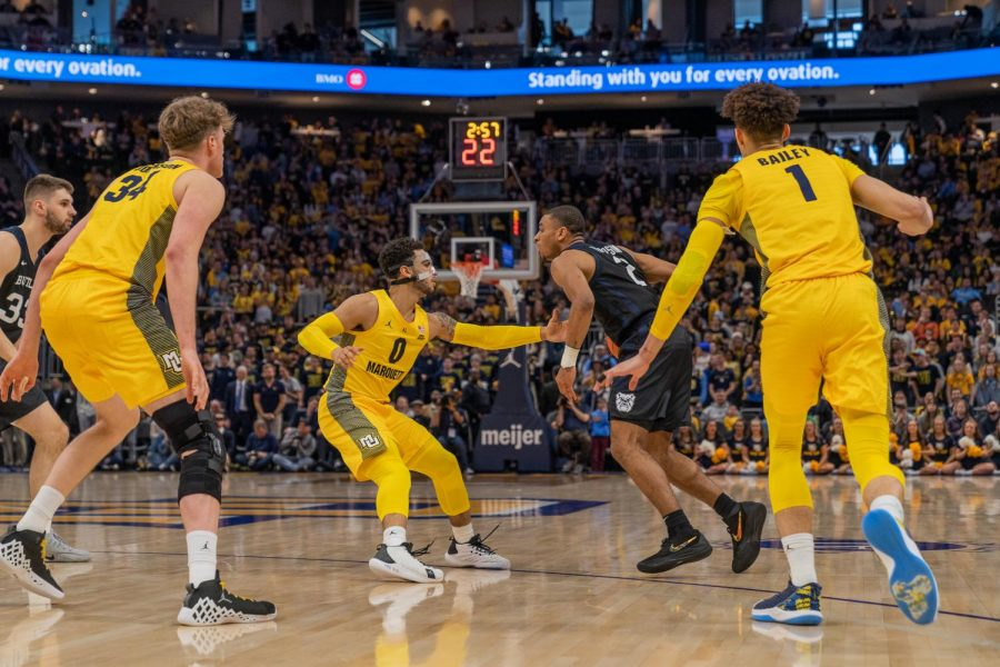 Markus Howard guarding Butler's Aaron Thompson in the Golden Eagles' 76-57 win over Butler on National Marquette Day Sunday.