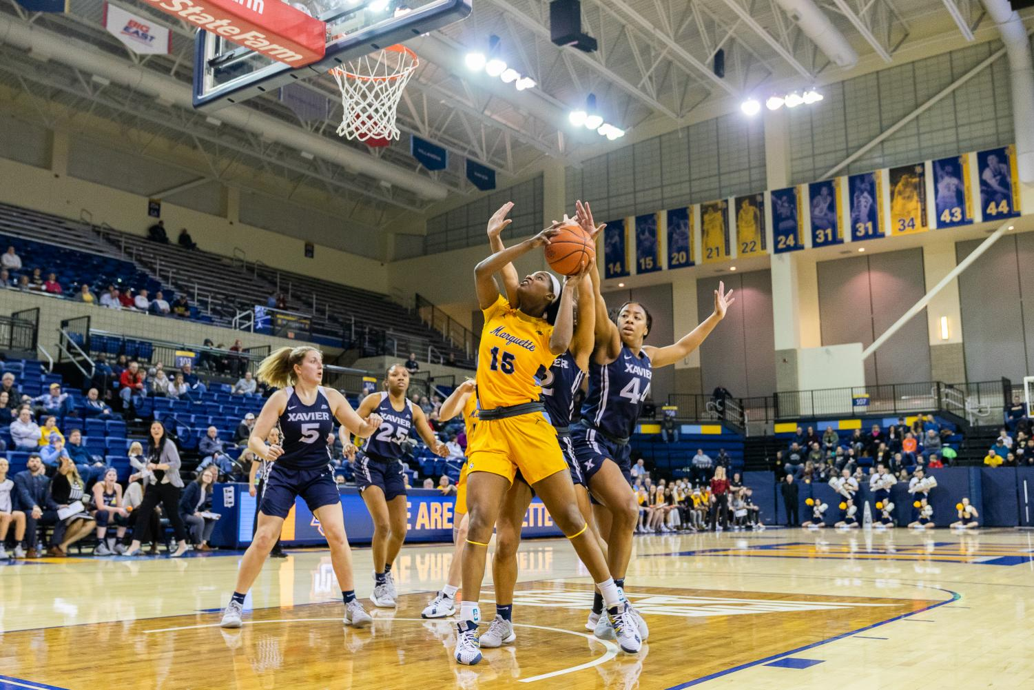 Camryn Taylor (15) goes up for the layup in Marquette's 61-48 win over Xavier.