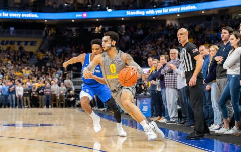 Markus Howard (0) dribbles in Marquette's 73-65 loss to Creighton Tuesday.